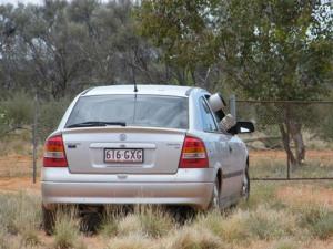 Ian using car as blind