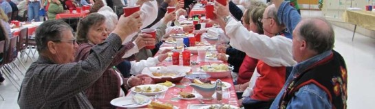 Fair Use credit: Norwegian Society of Texas, including Steve Ogden, toasting at Cranfills Gap Lutefisk Supper