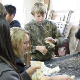 Students Skinning Codfish, in preparation for Cranfills Gap Lutefisk Supper